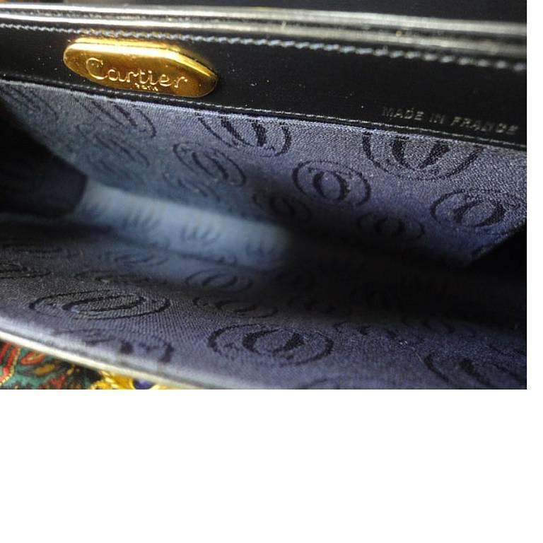 Vintage Cartier black navy  leather classic shape clutch bag with blue stone. 10