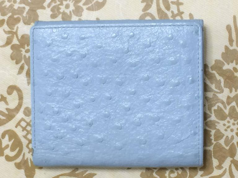 Blue Vintage Gianni Versace ostrich-embossed light blue leather wallet with sunburst For Sale