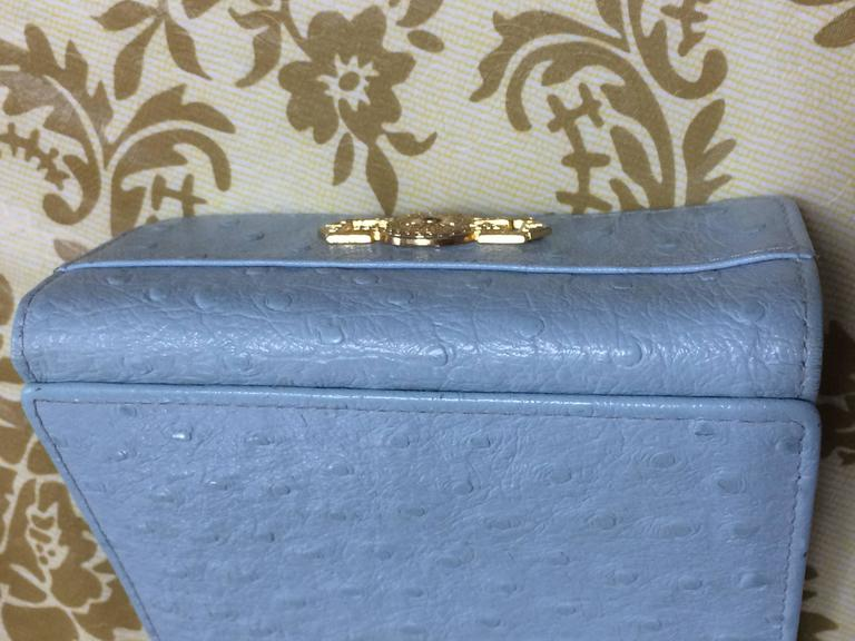 Women's or Men's Vintage Gianni Versace ostrich-embossed light blue leather wallet with sunburst For Sale