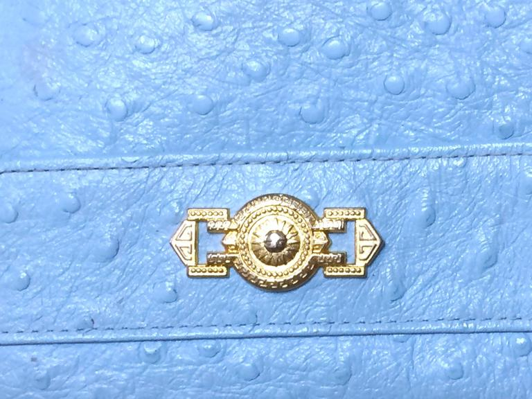 1990s. Vintage Gianni Versace ostrich-embossed light blue leather wallet with golden sunburst charm. Coin purse, card,bill case. Best gift   Here is another vintage piece from Gianni Versace, ostrich-embossed light blue leather wallet that can