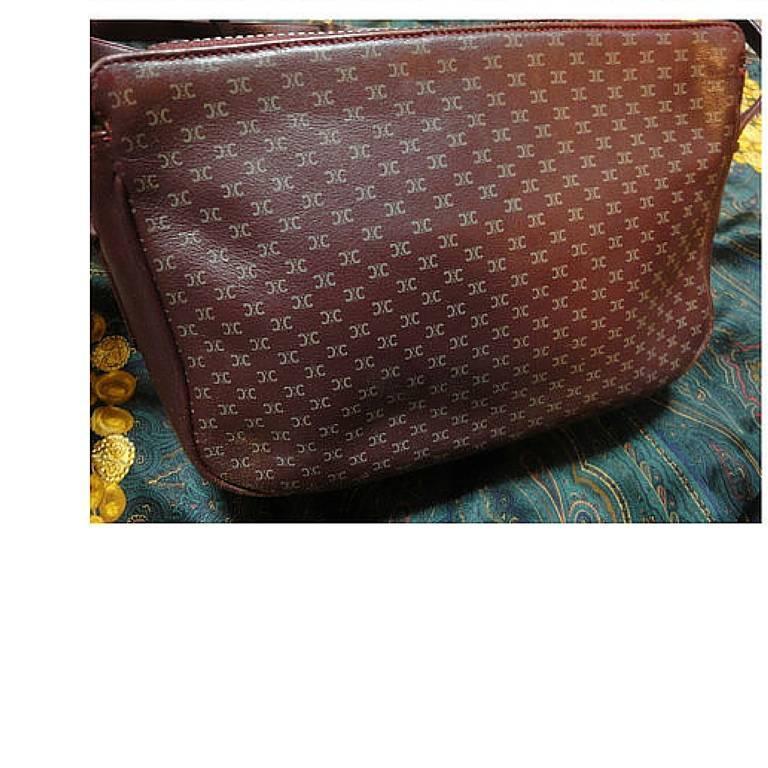 Black 80's vintage Celine shoulder purse in bordeaux, burgundy leather with blason. For Sale