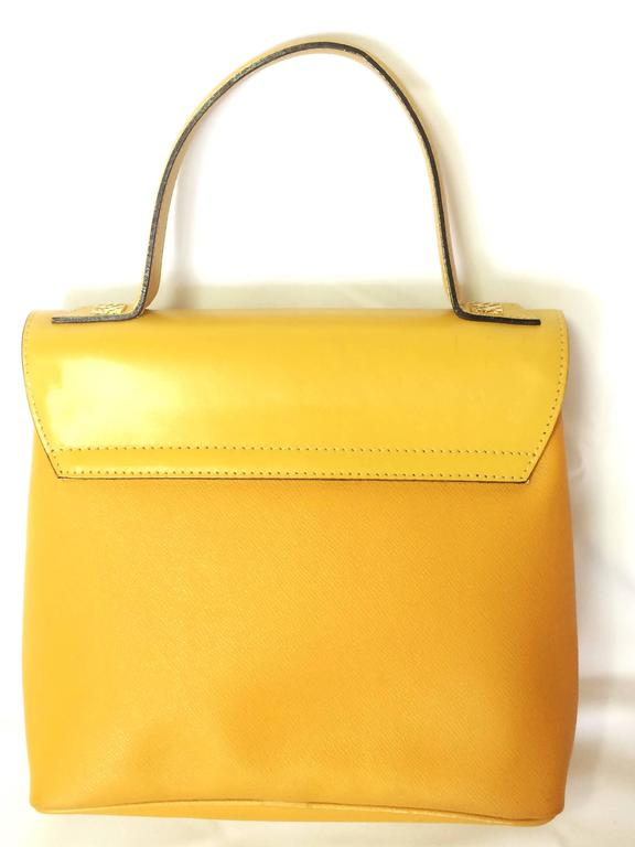 Yellow MINT. Vintage Nina Ricci yellow leather handbag purse with shoulder strap. For Sale