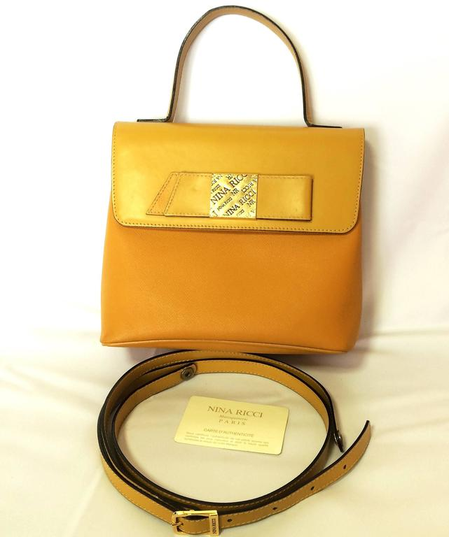 MINT. Vintage Nina Ricci yellow leather handbag purse with shoulder strap. For Sale 2
