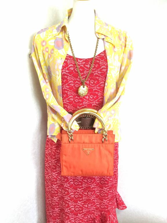 43fcdffa07036b Vintage PRADA orange nylon mini tote bag with golden chain and metallic  handles. at 1stdibs