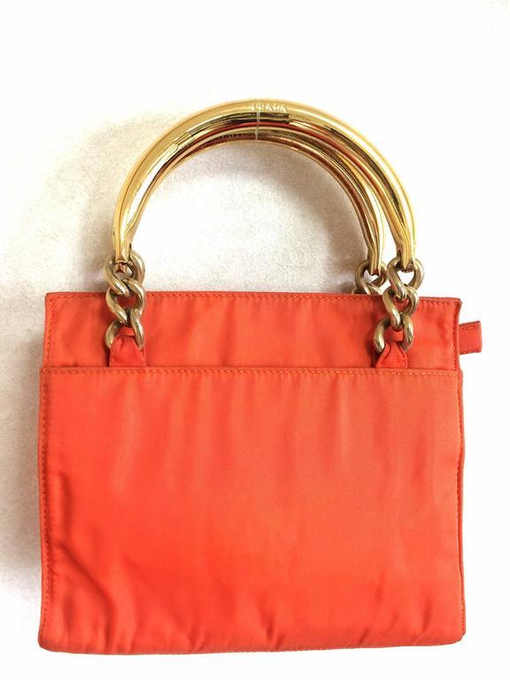 94efc23e0c4e ... australia 1990s. vintage prada orange nylon mini tote bag with gold  tone chain and metallic
