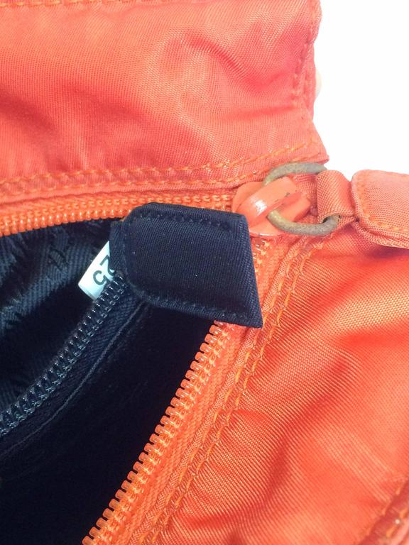 1959f658ba88 Vintage PRADA orange nylon mini tote bag with golden chain and metallic  handles. at 1stdibs