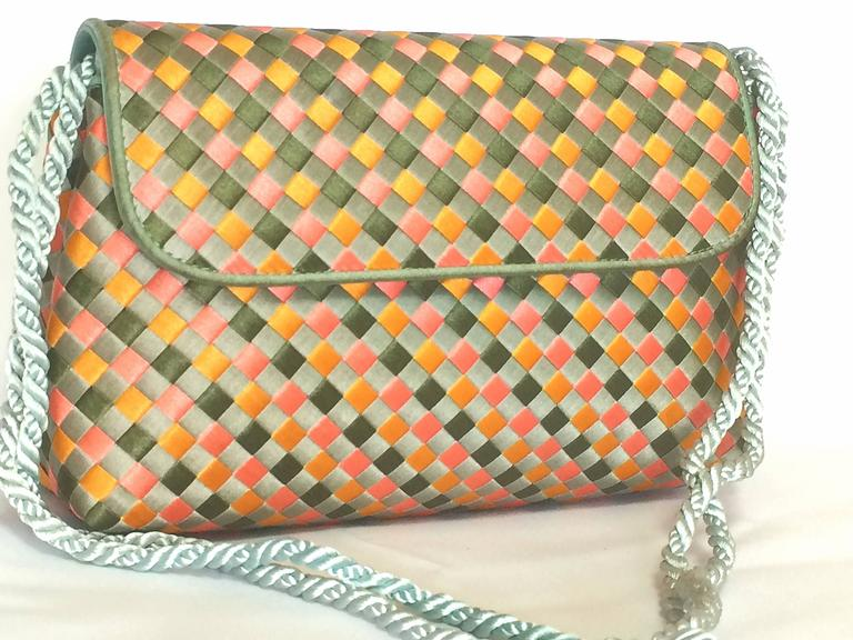 1990s. Vintage Bottega Veneta woven satin, classic intrecciato handbag purse in pink, orange, light blue, and green color. Can be clutch pouch.  Introducing a rare classic masterpiece from Bottega Veneta's iconic intrecciato purse from approx