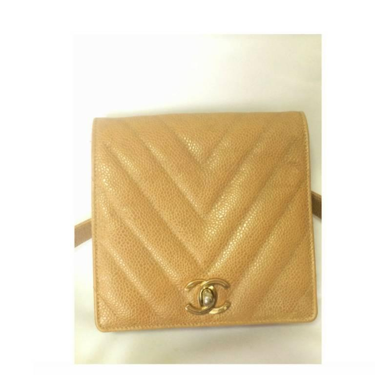 """Introducing a vintage CHANEL beige brown caviar leather waist belt purse, fanny pack with golden chain and chevron stitch. Waist size 25.4"""", 26.5"""", 32.3"""", 33.5"""", and 34.6"""" (64.5cm, 67.5cm, 82cm, 85cm, and 88cm) would fit in. Featuring a gold tone"""