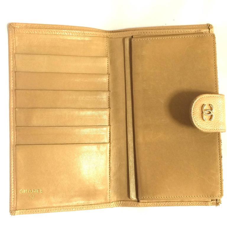 Orange Vintage CHANEL beige caviar wallet with gold tone CC motif. Classic purse. For Sale