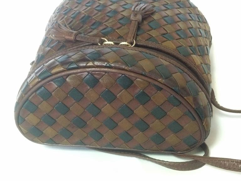 1990s. Vintage Bottega Veneta brown, khaki, and dark green triple color intrecciato lunchbox, fisherman bag shape shoulder bag. Mini purse.