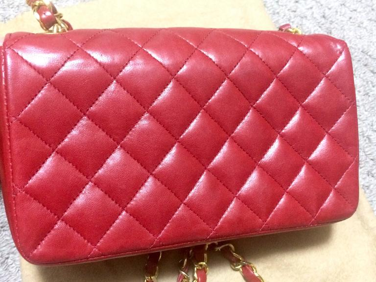 Red Vintage CHANEL classic mini flap 2.55 shoulder bag in lipstick red lambskin. For Sale