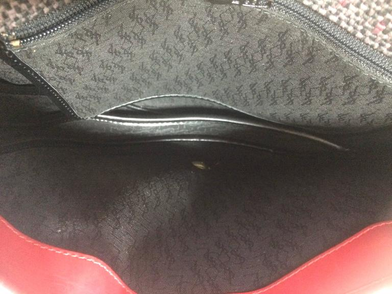 Vintage Yves Saint Laurent oval navy shoulder bag with red shoulder straps. For Sale 4