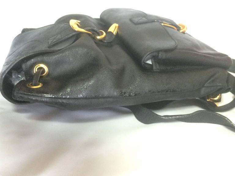 Women's or Men's Vintage Gianni Versace black leather backpack with a big embossed medusa mark. For Sale