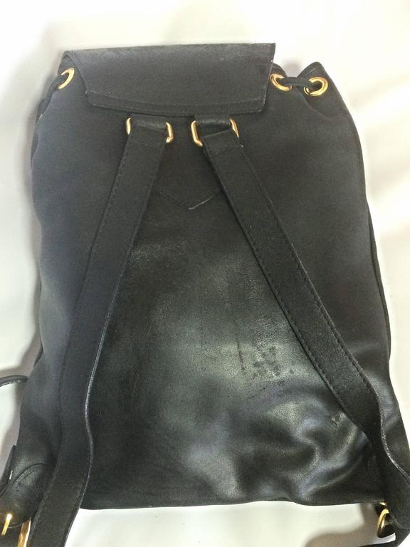Vintage Gianni Versace black leather backpack with a big embossed medusa mark. For Sale 2