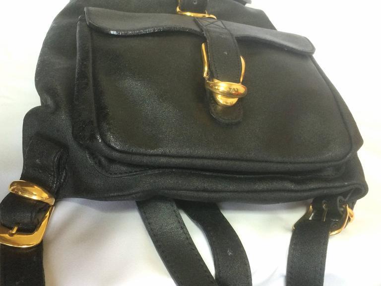 Vintage Gianni Versace black leather backpack with a big embossed medusa mark. 4