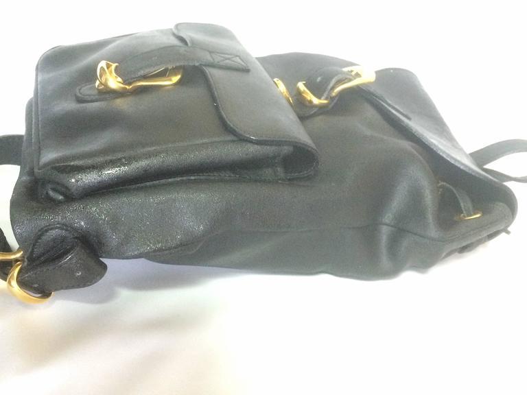 Vintage Gianni Versace black leather backpack with a big embossed medusa mark. For Sale 1
