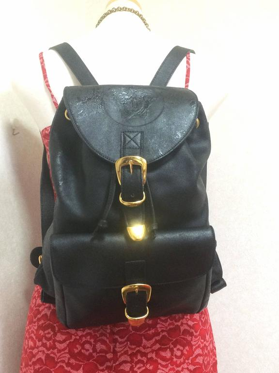 Vintage Gianni Versace black leather backpack with a big embossed medusa mark. 10