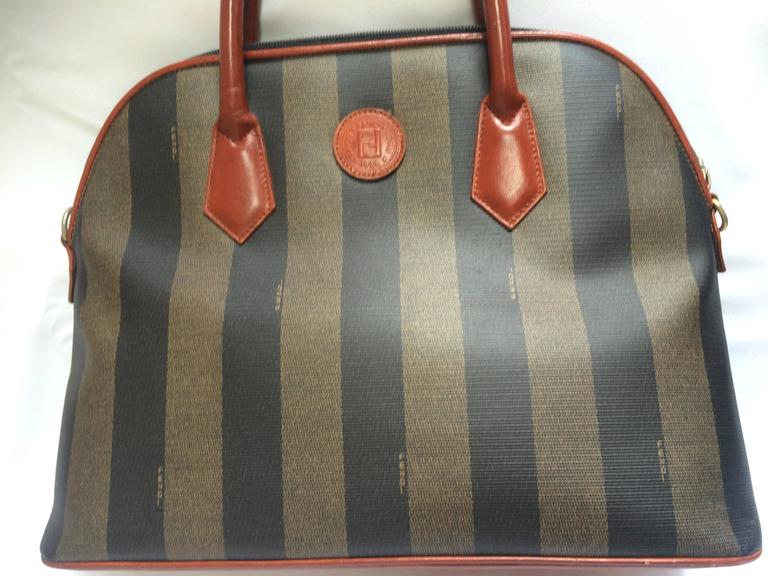 1990s. Vintage FENDI pecan khaki and grey stripe mid size tote bag with brown leather handles and trimmings in bolide shape.