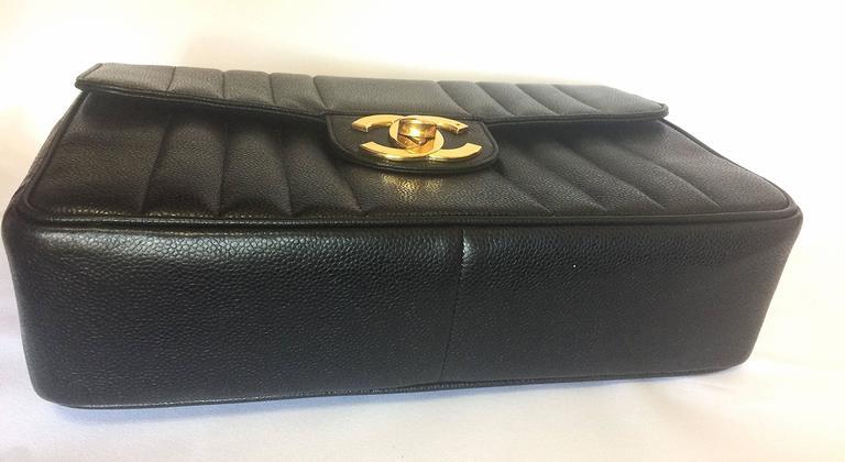 Vintage CHANEL black 2.55 jumbo caviar large shoulder bag, vertical stitches. 5