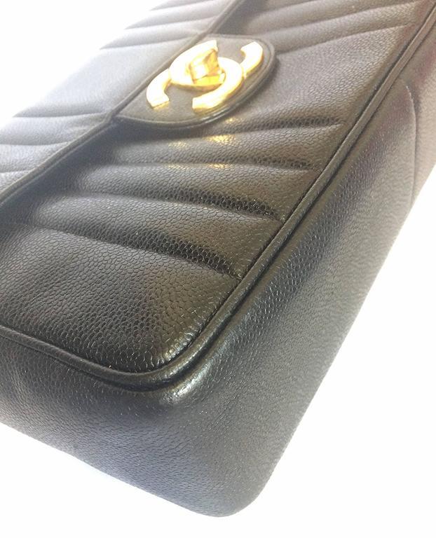 Vintage CHANEL black 2.55 jumbo caviar large shoulder bag, vertical stitches. 6