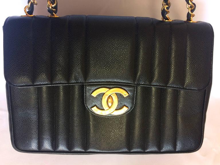Vintage CHANEL black 2.55 jumbo caviar large shoulder bag, vertical stitches. 2