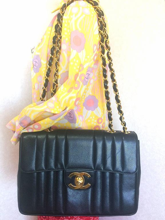 Vintage CHANEL black 2.55 jumbo caviar large shoulder bag, vertical stitches. 10