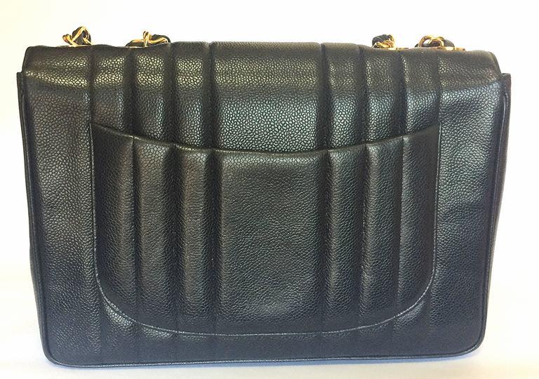 Vintage CHANEL black 2.55 jumbo caviar large shoulder bag, vertical stitches. 3