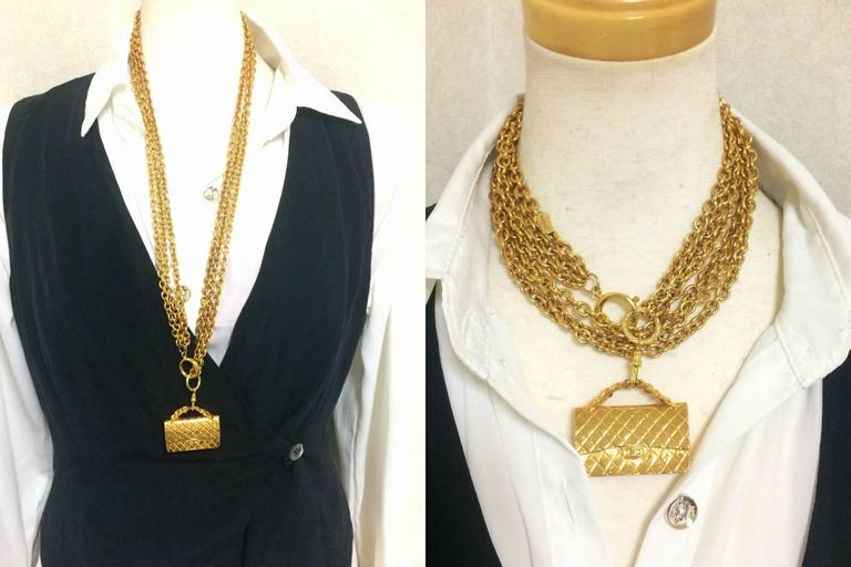 1990s. Vintage CHANEL golden double chain long necklace with classic 2.55 bag charm, pendant top. Can be worn in double chain too.  If you are looking for a vintage jewelry from CHANEL back in the old era, then this is the must-have-masterpiece