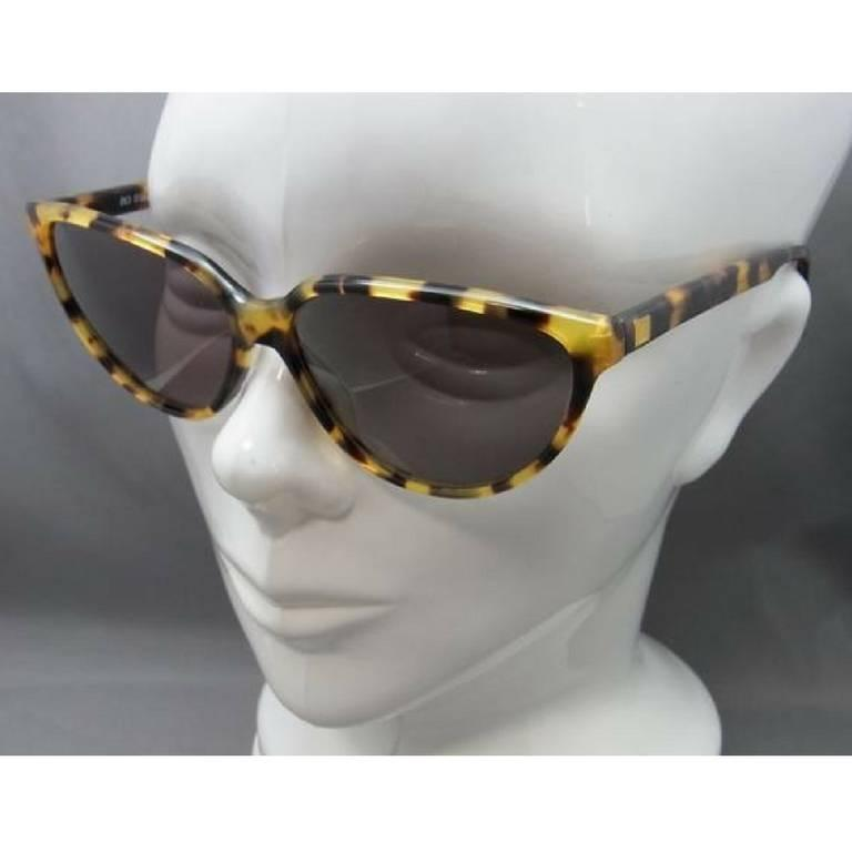 1980's vintage Balenciaga French made tortoiseshell style marble brown frame sunglasses. Original mod style.  This is a vintage  brown sunglasses with dark grey UV shadow with grey shades from BALENCIAGA back in the old era.  Feels like celebrity