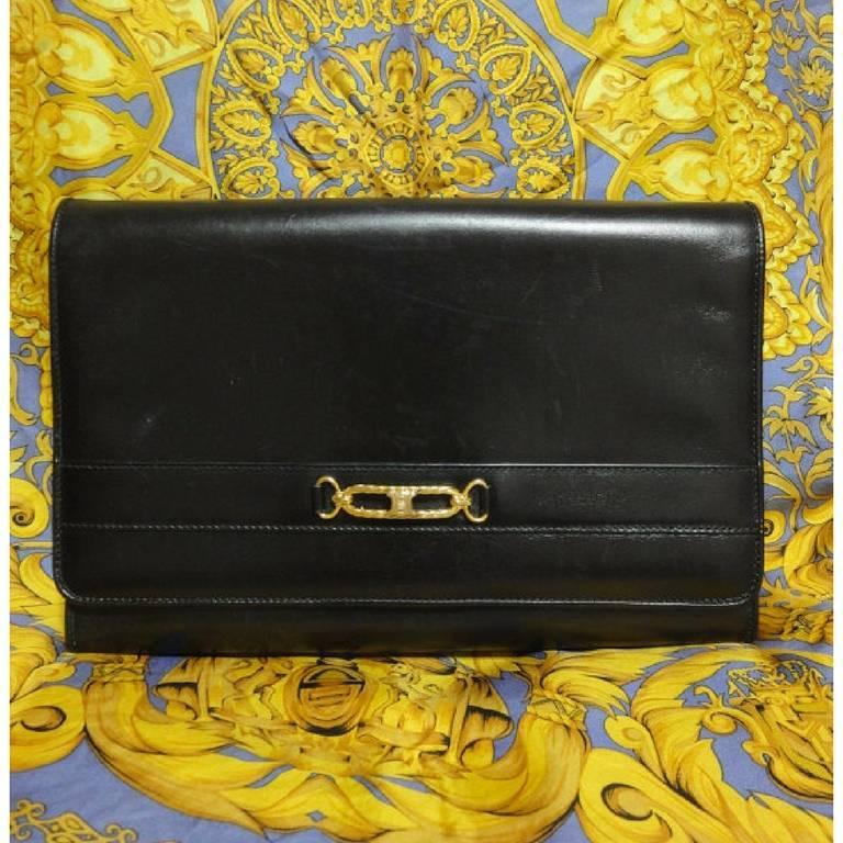 Vintage Celine black calfskin leather clutch bag with iconic golden logo motif. 5