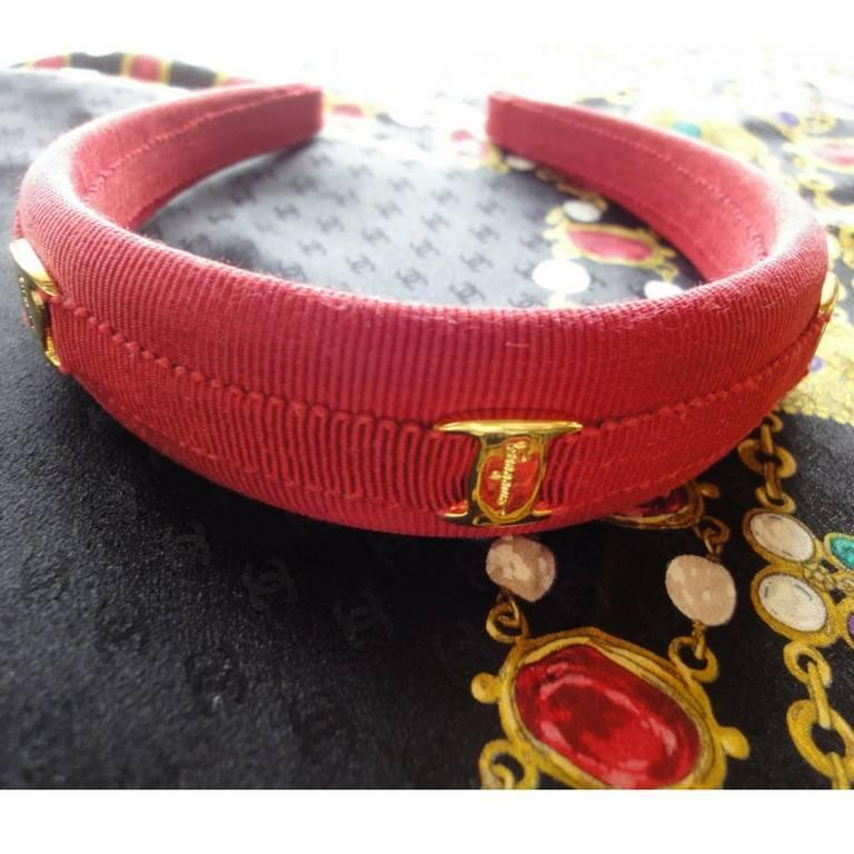 Vintage Salvatore Ferragamo vara golden logo embossed charm red head band. 2