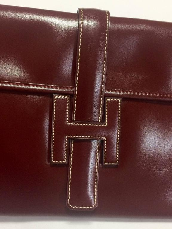 1980's vintage HERMES jige, document case, dark wine, bordeaux boxcalf portfolio purse, iPad case. Classic and sophisticated style.  This is a vintage HERMES jige in dark wine/bordeaux color boxcalf leather, PM size. Beautiful and great masterpiece