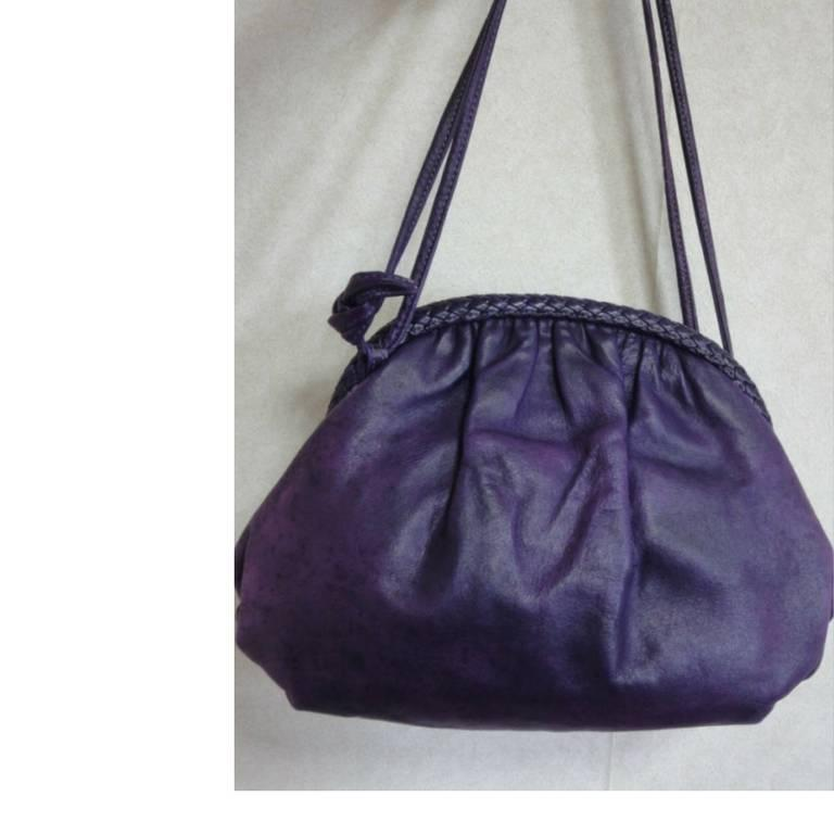 1980s. Vintage BALLY deep purple, violet genuine leather pouch, clutch style shoulder bag with golden B charm and braided kiss lock closure.  This is a vintage Bally genuine calfskin shoulder bag in pouch/clutch style. Featuring its iconic gold tone