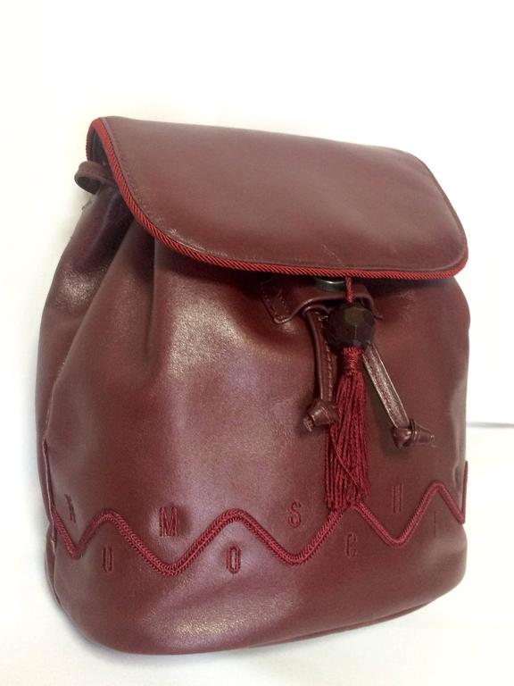 Vintage MOSCHINO dark wine leather backpack with tassel and logo embroidery. In Excellent Condition For Sale In Kashiwa, Chiba