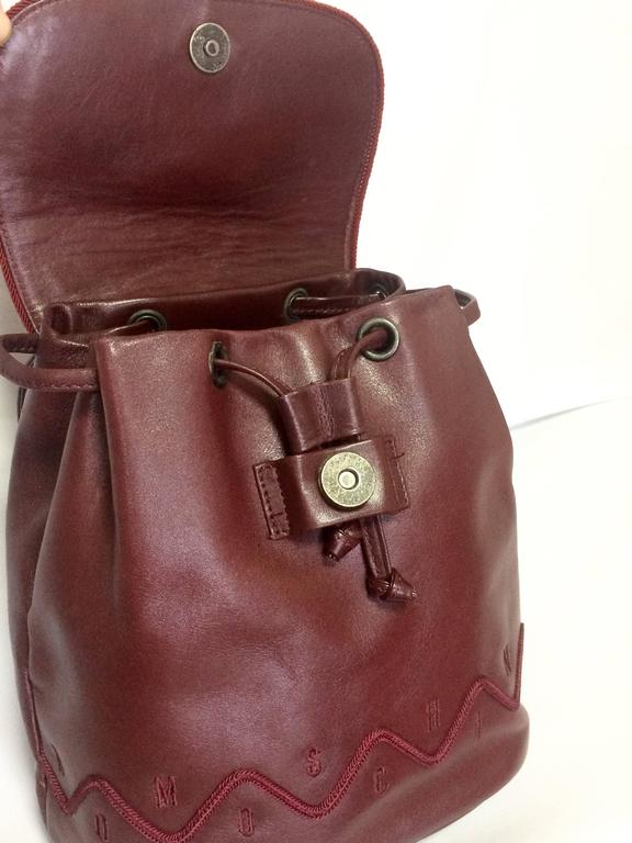 Vintage MOSCHINO dark wine leather backpack with tassel and logo embroidery. For Sale 3