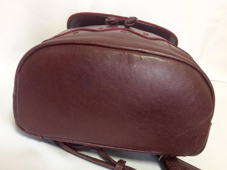Vintage MOSCHINO dark wine leather backpack with tassel and logo embroidery. For Sale 1