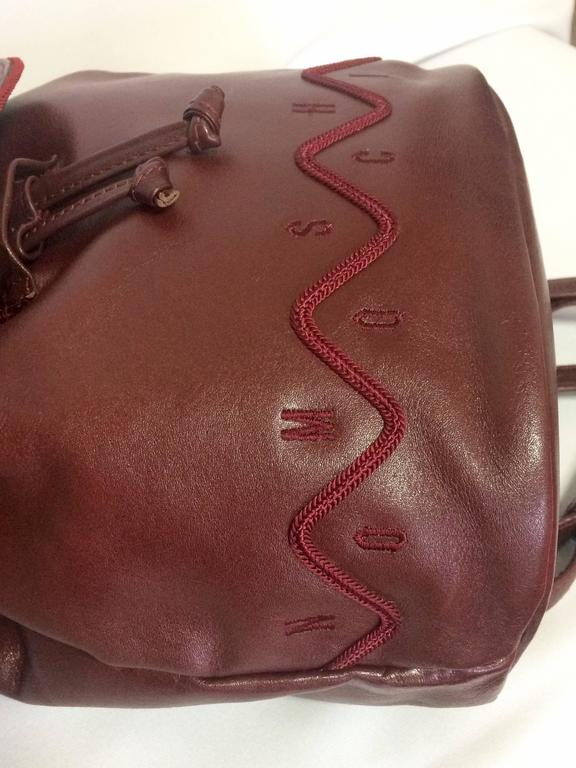 Vintage MOSCHINO dark wine leather backpack with tassel and logo embroidery. For Sale 2