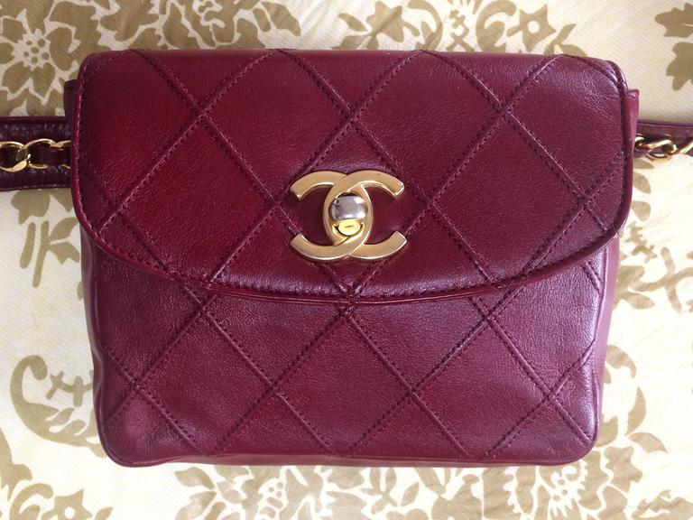 Vintage CHANEL wine leather waist purse, fanny pack with golden chain belt. 2