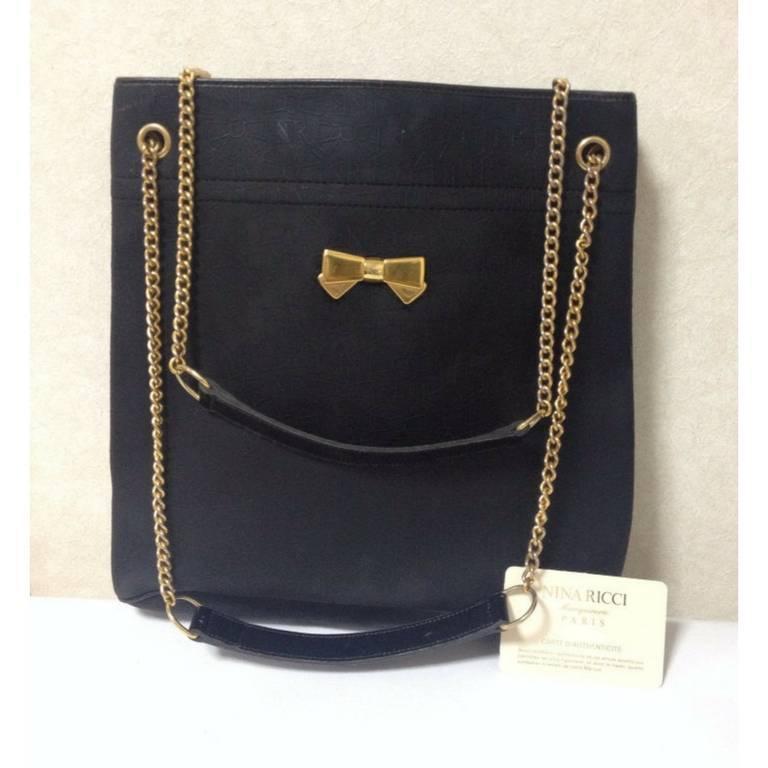 Vintage Nina Ricci Black Tote Bag With Golden Chain Straps Logo Bow
