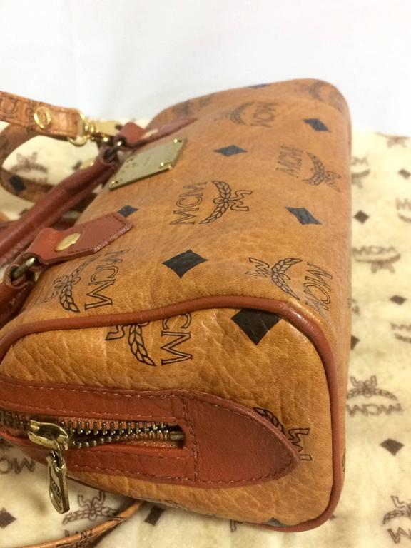 Women's or Men's Vintage MCM monogram mini speedy bag with shoulder strap, by Michael Cromer. For Sale