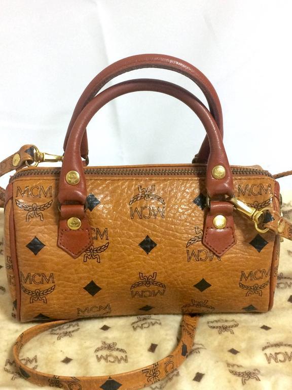 Brown Vintage MCM monogram mini speedy bag with shoulder strap, by Michael Cromer. For Sale