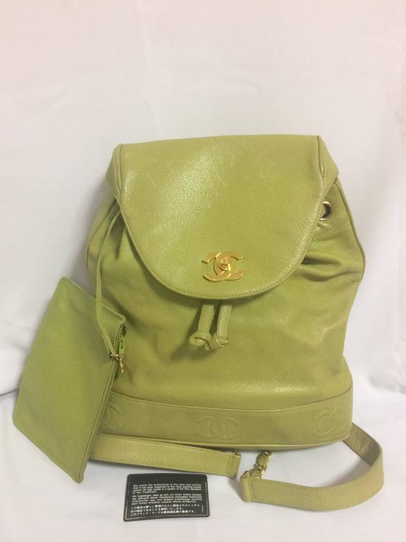 1990s. Vintage CHANEL green caviar leather backpack with gold chain strap and CC closure. Classic but rare color.  Rare color in classic caviar leather as backpack from CHANEL back in the 90's.  Don't miss it!  Introducing another vintage FAB piece,
