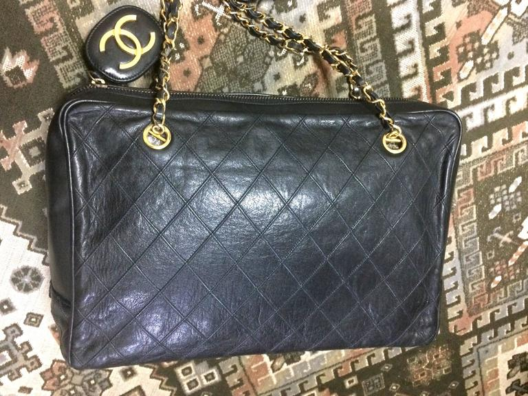 Vintage CHANEL black goatskin shoulder bag with gold tone chains and cc charm. 2