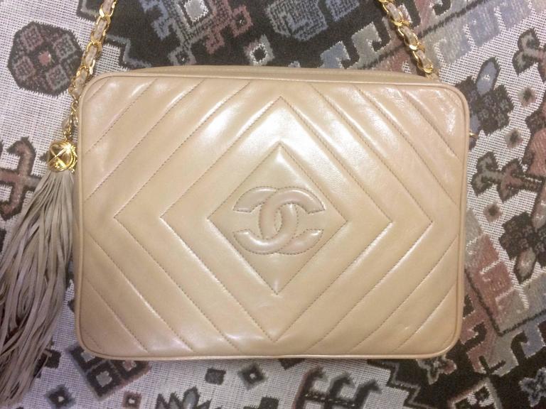 Beige Vintage Chanel beige lamb camera bag style shoulder bag, Chevron, diamond stitch For Sale
