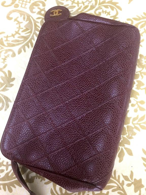 Women's or Men's Vintage CHANEL wine brown caviar leather cosmetic, toiletries, makeup pouch. For Sale