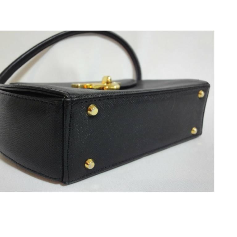 Vintage MOSCHINO black leather handbag, oval shape purse with golden logo motif. 5