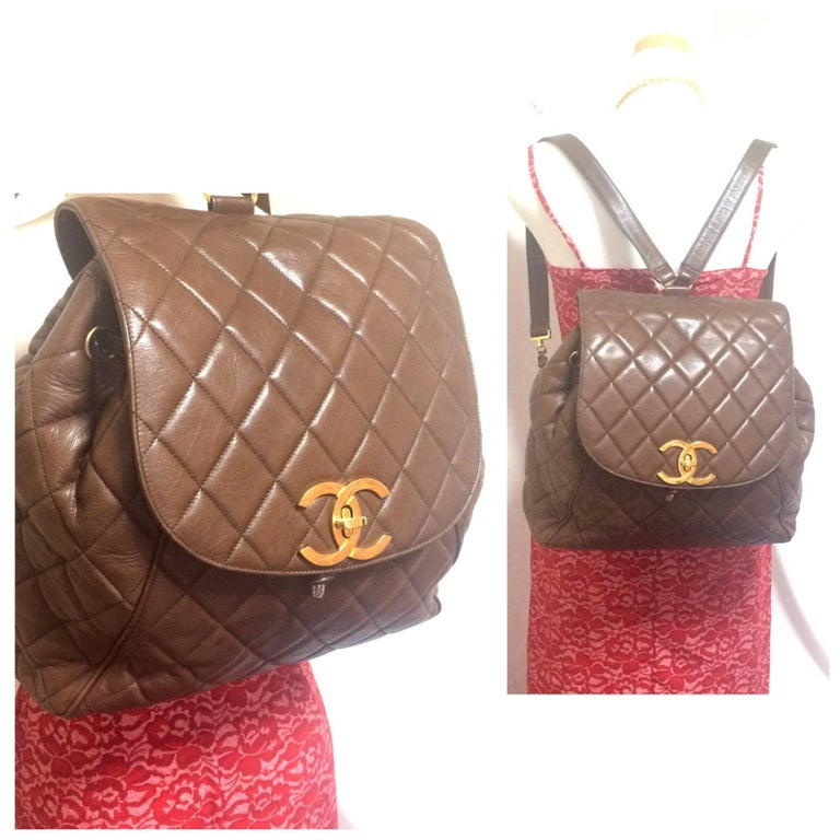 Brown Vintage CHANEL quilted brown lamb leather backpack with gold chain and large CC. For Sale