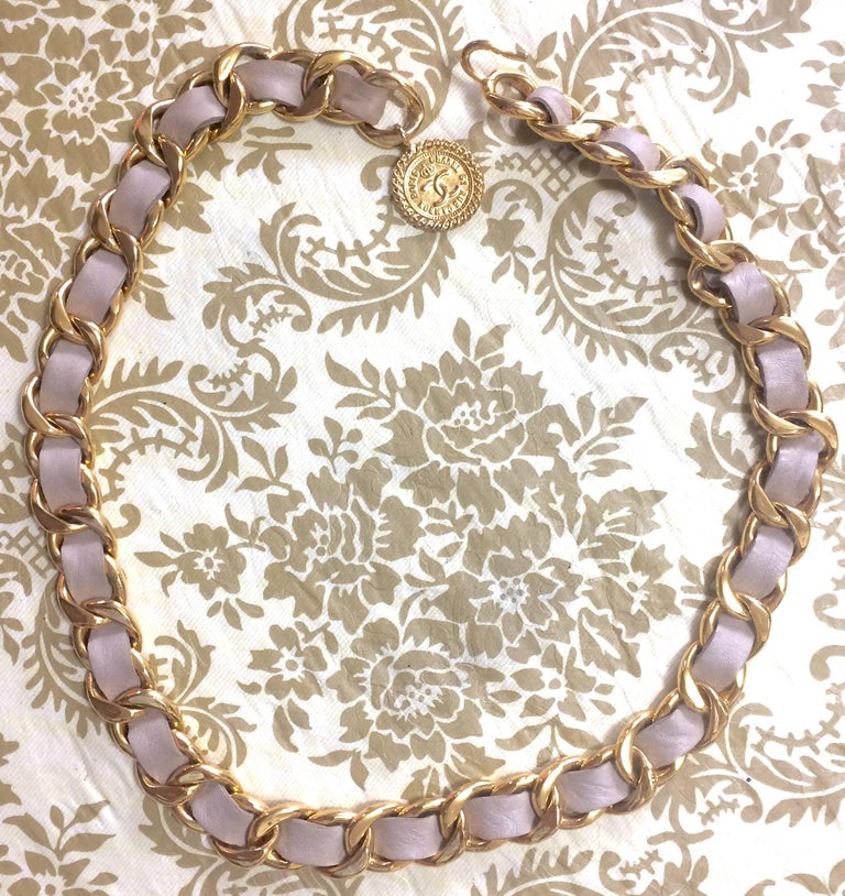 Beige Vintage CHANEL beige leather thick chain belt with golden CC and mademoiselle. For Sale
