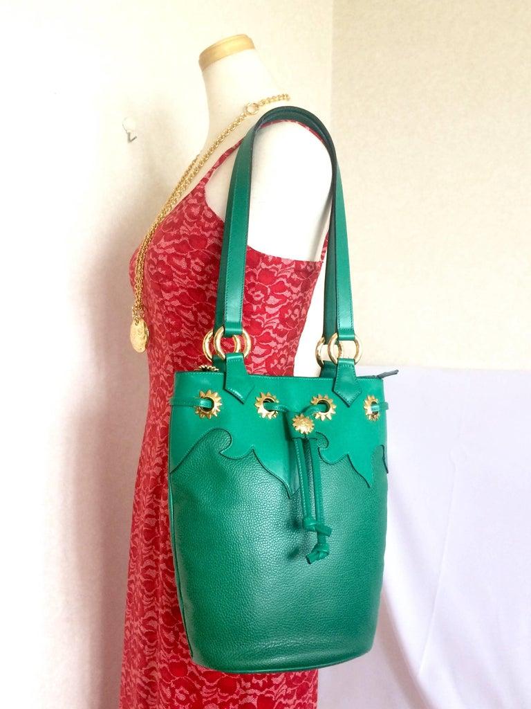 Vintage Christian Lacroix green hobo bucket shoulder bag with golden star motifs For Sale 4