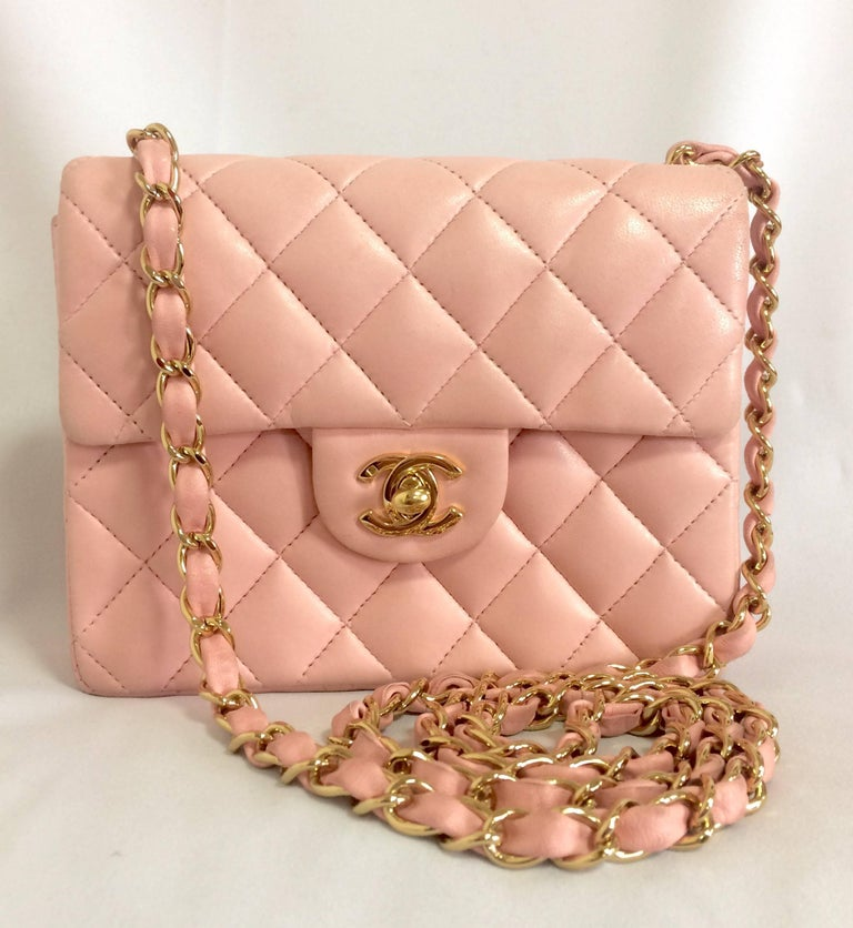 Vintage CHANEL milky pink lamb leather flap chain shoulder bag, classic 2.55 mini purse with gold tone CC closure.  Introducing one of the most popular pieces from CHANEL back in the era, vintage Chanel pink lamb leather shoulder bag with golden CC